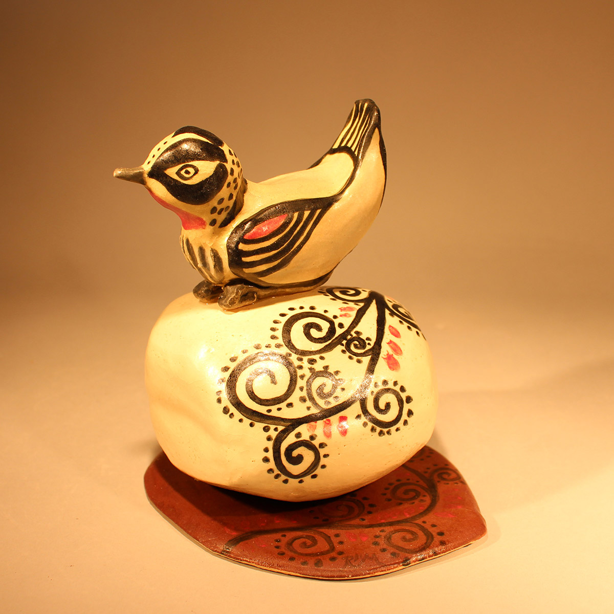 Painted Bird on Stone<br/>with Spiral Design